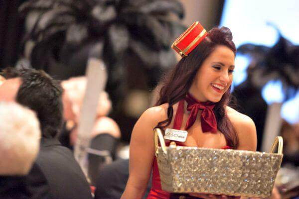 Chelsie, Elite Team member working passionately at a casino night fundraising event in Pittsburgh