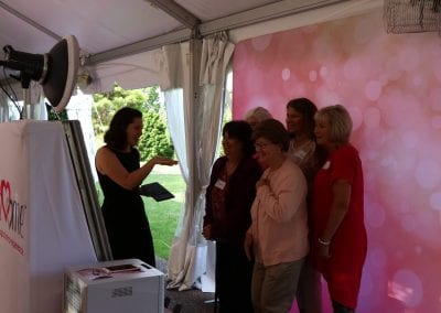 Guests Enjoying The Mirror Photo Booth